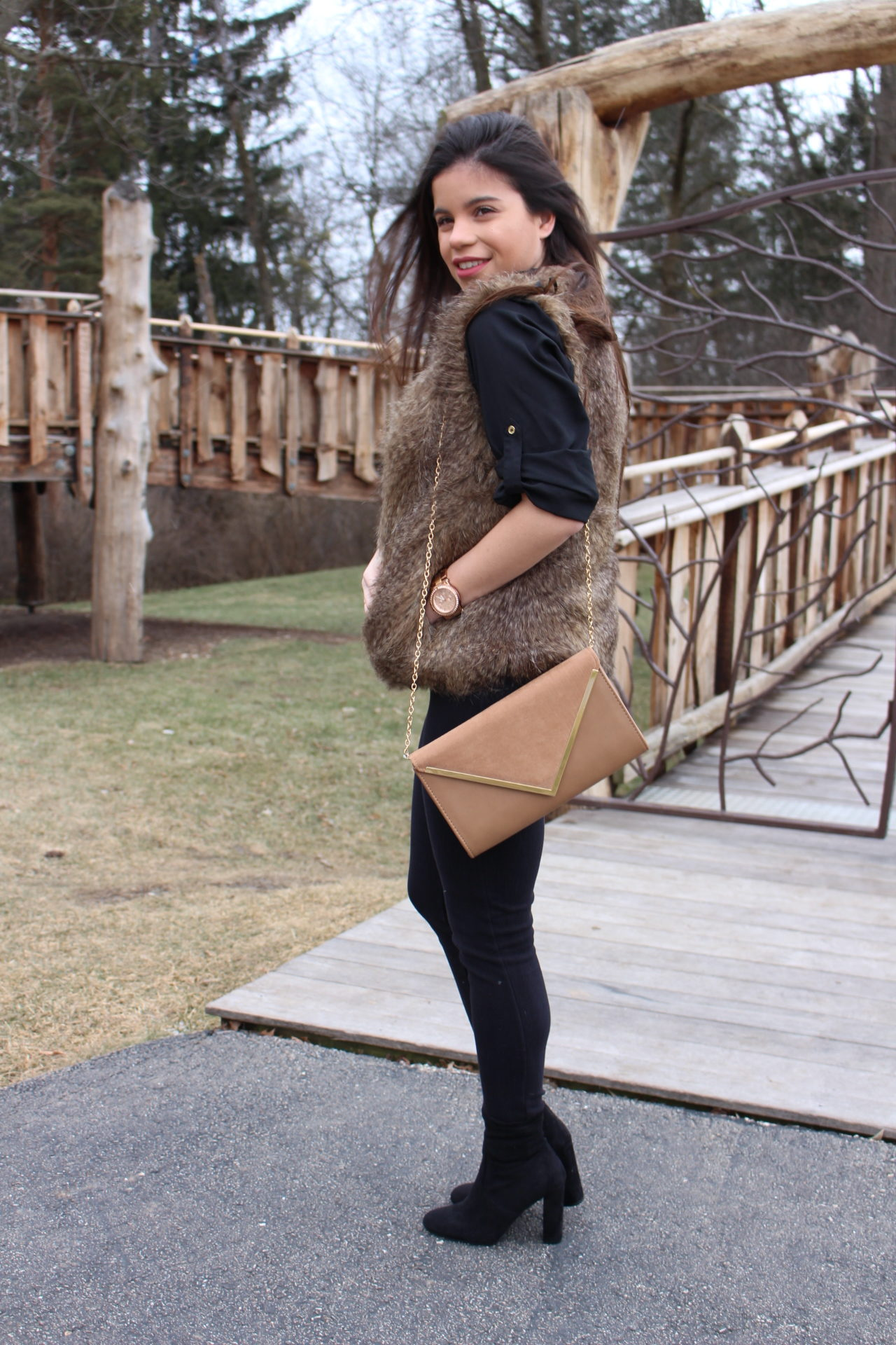 all black outfit for winter with pop of color by alejandra avila