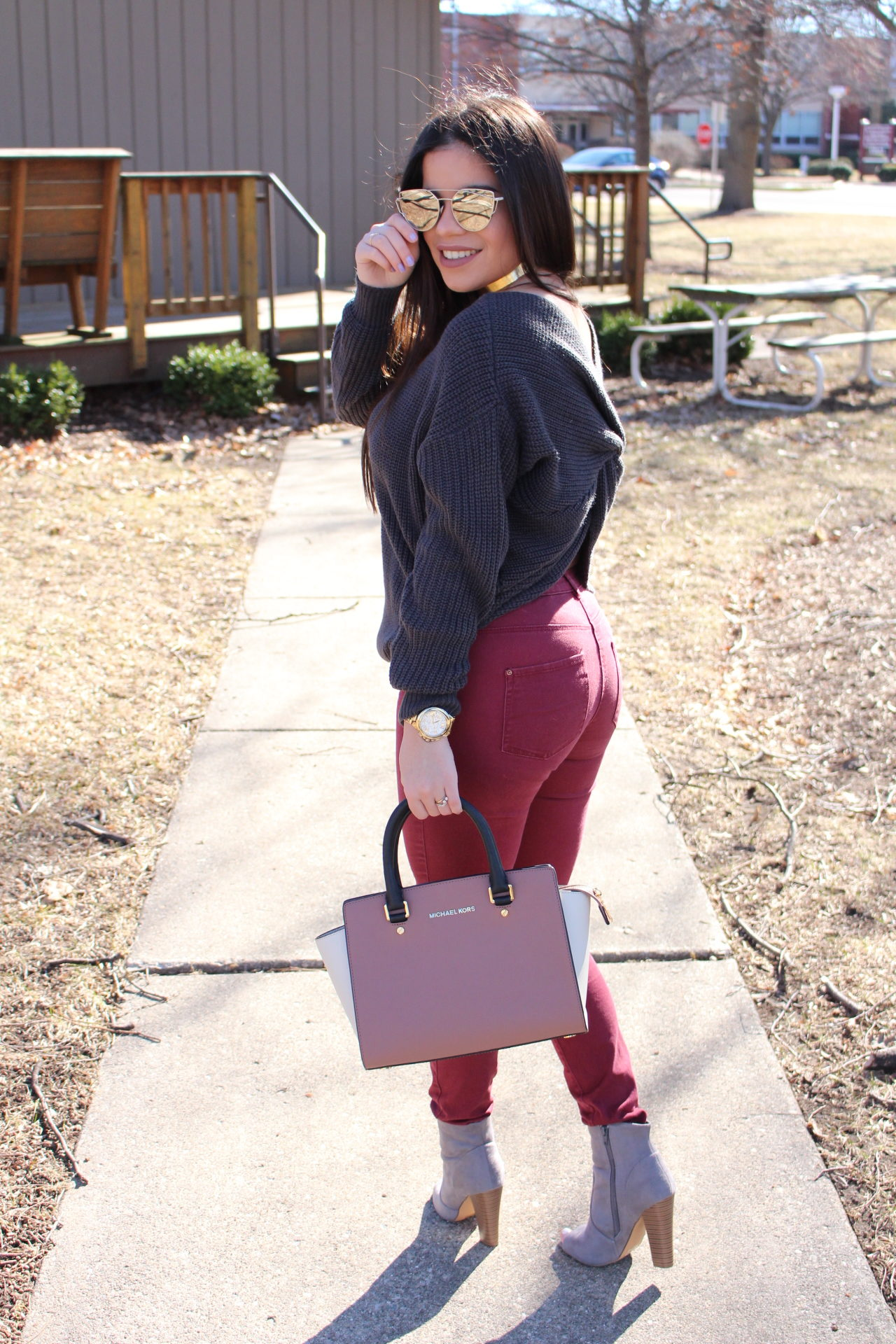 outfit gray sweater twited back burgundy jeans michael kors mk quay by alejandra avila